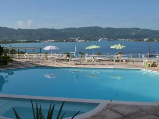 1 bed 1 bath Apartment For Sale in Upperdeck Condominiums, St. James, Jamaica